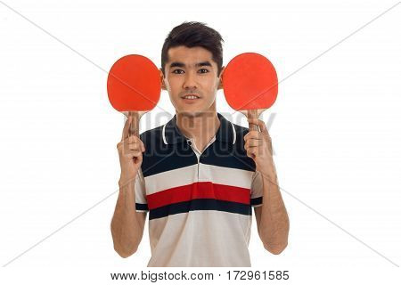 Beauty young sports man with rackets in uniform practicing table tennis isolated on white
