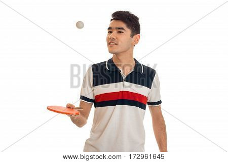 Cheerful young sports man with rackets in uniform practicing table tennis isolated on white