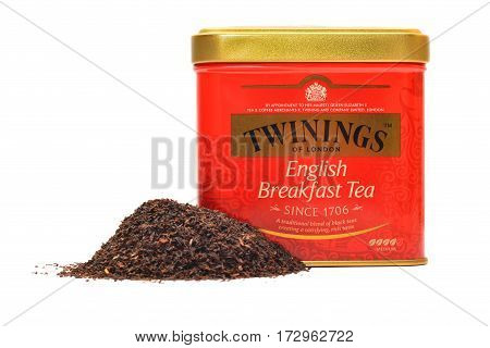 Caransebes Romania - October 26 2015: An english tea can with a pile of dried tea isolated on white background. Shot taken on October 26th 2015