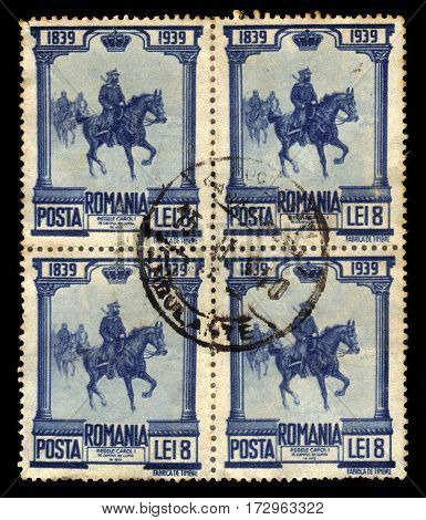 ROMANIA - CIRCA 1939: A stamp printed in Romania shows King Carl I (King of Romania) on horseback in battle, circa 1939