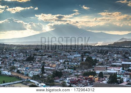 A view of Popocatepetl volcano mountain behind Puebla city