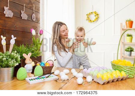 Happy Mother And Her Cute Child Celebrating Easter At Home