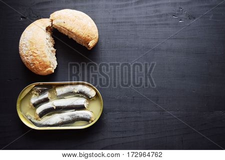 metal can with conserved herring fish, canned marinated herring,  open tin can , Top view.
