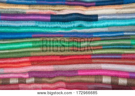 Background from the pile of cashmere stoles