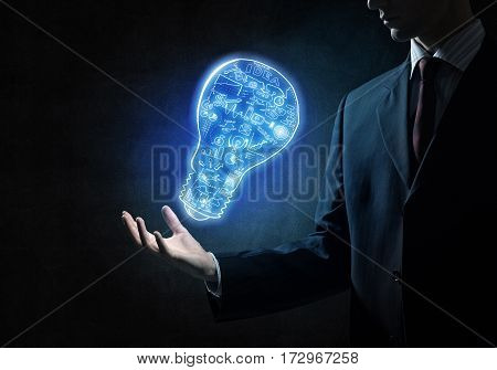 Close of businessman showing sketched idea in palm