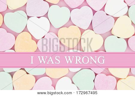 Retro apology message Retro heart shaped candy on pick fabric with text I was wrong