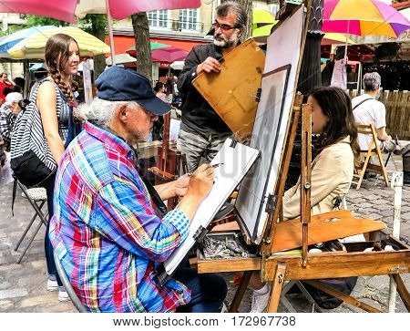 PARIS, FRANCE-JULY, 2016: Montmartre Street Painters, colorful and famous Place du Tertre