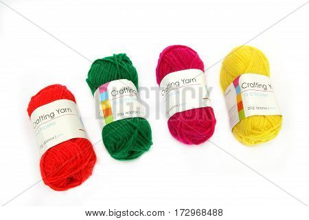 Camberley, Uk - Feb 22Nd 2017: Four Balls Of Colourful Red, Green, Yellow And Pink Wool Or Yarn On A
