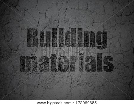 Constructing concept: Black Building Materials on grunge textured concrete wall background