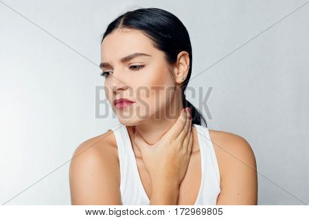 Illness Health Care people Medicine concept - Throat Pain. Closeup Of Sick Woman With Sore Throat Feeling Bad Suffering From Painful Swallowing. Beautiful Girl Touching Neck With Hand