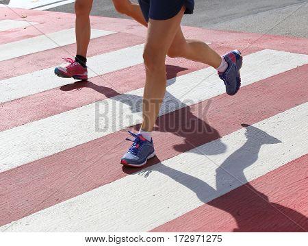 Marathoners Run Very Fast Over The Pedestrian Crossing In The Ci