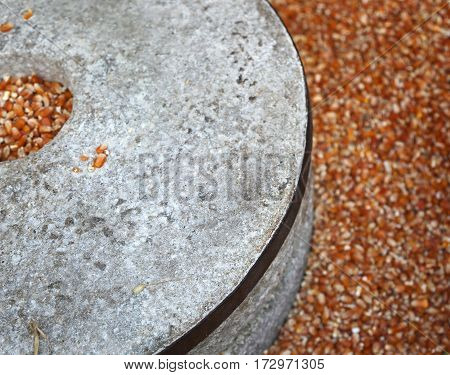 Old Millstone And The Seeds Of Wheat To Make Flour