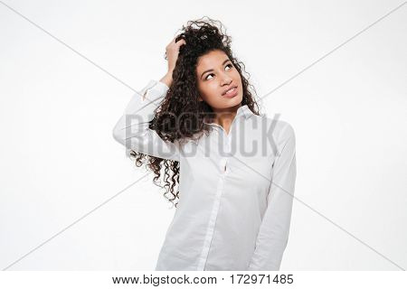 Thoughtful african young businesswoman thinking and looking away over white background