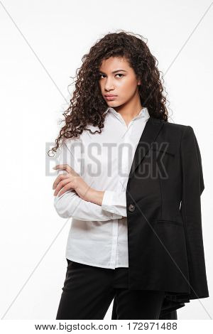 Serious african young businesswoman standing with arms crossed over white background