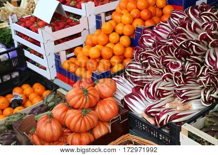 Stall Of Greengrocer With Tomatoes Radicchio Oranges And Lots Of
