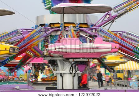 nacelle of a fast carousel as it spins wildly