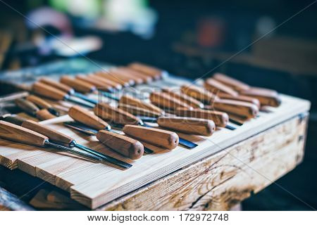 Old carpenter tools in pine wood table