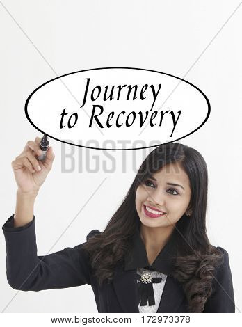 businesswoman holding a marker pen writing -journey to recovery