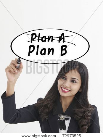 businesswoman holding a marker pen writing -plan b