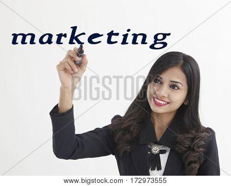 businesswoman holding a marker pen writing -marketing