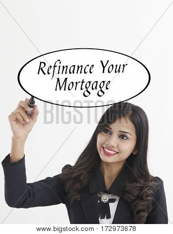 businesswoman holding a marker pen writing -refinancing your mortgage