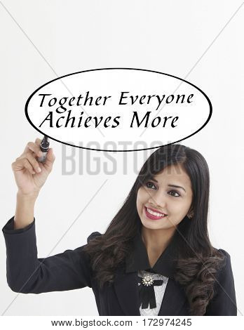 businesswoman holding a marker pen writing -together everyone achieves more