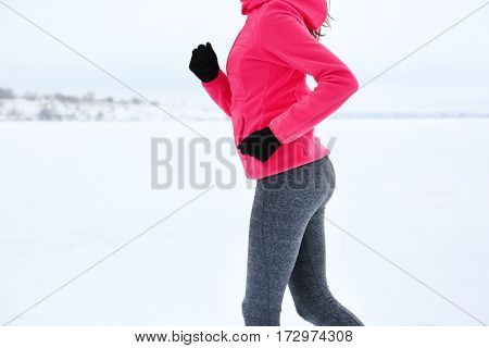 Young woman jogging on winter day