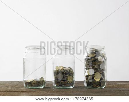 Blackboard and three saving jars from little coins ,half to full.