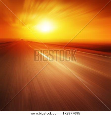 Empty asphalt road in motion blur at sunset.