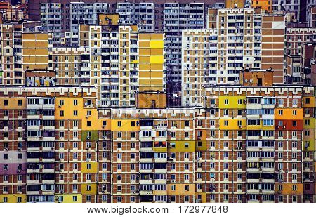 Apartment buildings sample of Soviet architecture. Urban residential areas in Kiev, Ukraine. Multi-colored buildings on a cloudy day