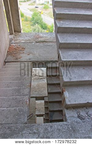 stairs inside abandoned building near the town
