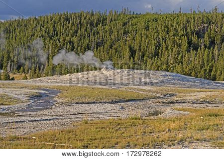 Evening Light on the Old Faithful Geyser Cone in Yellowstone National Park in Wyoming