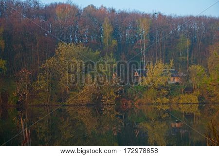Forester's Cabin by the river in the forest