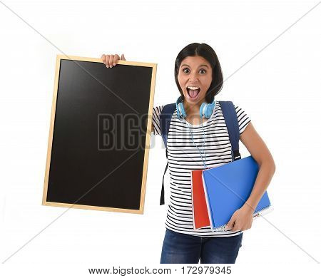 young beautiful hispanic woman or female student holding blank blackboard with copy space for adding message isolated on white background in school teacher and university education concept