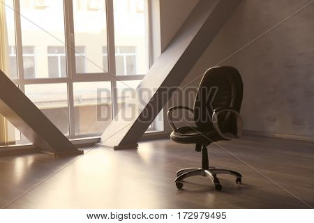 Swivel desk chair in empty office