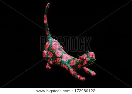Cat handmade colored decoration isolated on black color