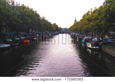 View on one of Amsterdam canals from the bridge.