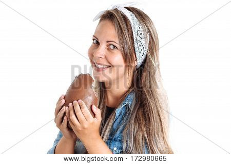 Young Brazilian Woman Eating Chocolate Easter Egg