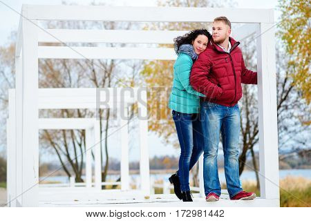 Romantic Of Couple Love Sitting On The Stone Looking Sunset At Mountain And Sea