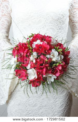 Red and white wedding bouquet of alstroemeria and fresia flowers