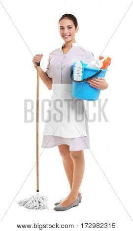 Hotel female chambermaid holding cleaning supplies on white background