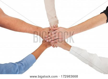 Group Of A People Stacking Hands Together On White Background