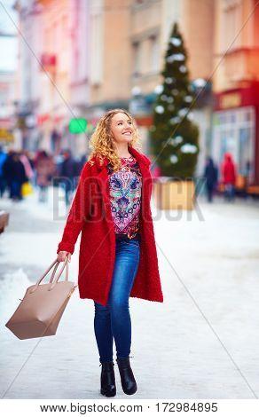 Happy Beautiful Woman Walking On Crowded Street In Winter