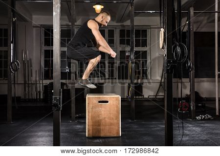 Young Athlete Man Doing A Box Jump Exercise In The Gym