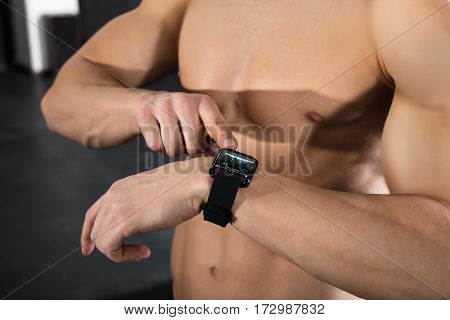 Close-up Of An Athlete Man Checking His Heart Rate Using Smart Watch