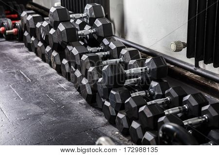 Rows Of Dumbbell In An Empty Gym