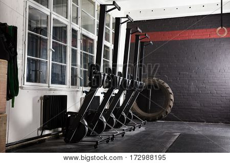 Row machines Standing In An Empty Gym