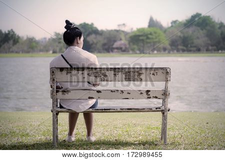 Beautiful Lonely Woman In Frustrated Depression Sitting Alone On Bench In Park., Concept Of Lonely,