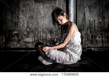 Drug Abuse Concept., Overdose Asian Female Drug Addict Use Syringe Injection Narcotic To Her Hand.,