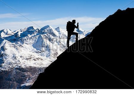 Silhouette Of A Man Hiking On Rocky Mountain Exploring Scenic View